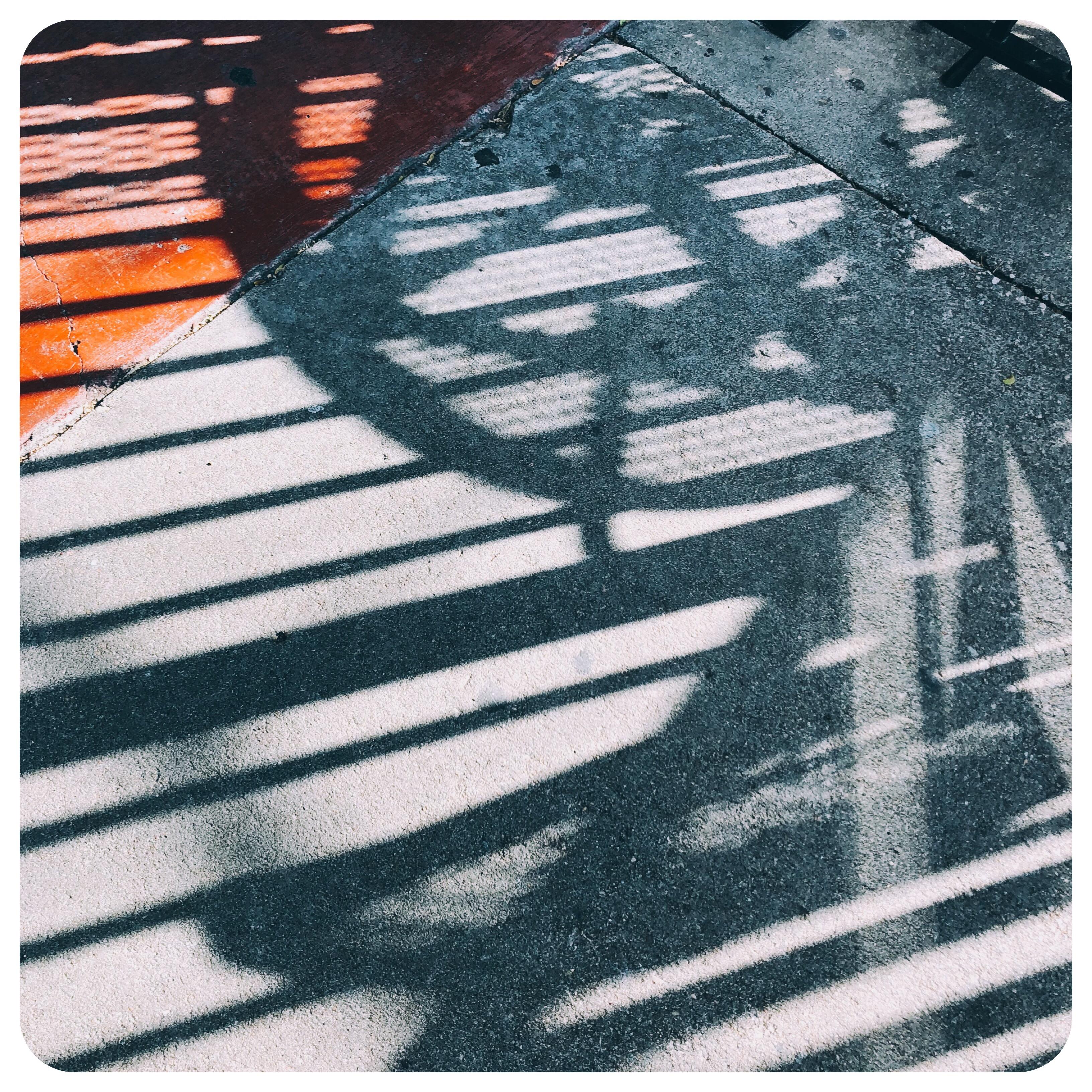 Shadows reflecting on sidewalk Lawrence