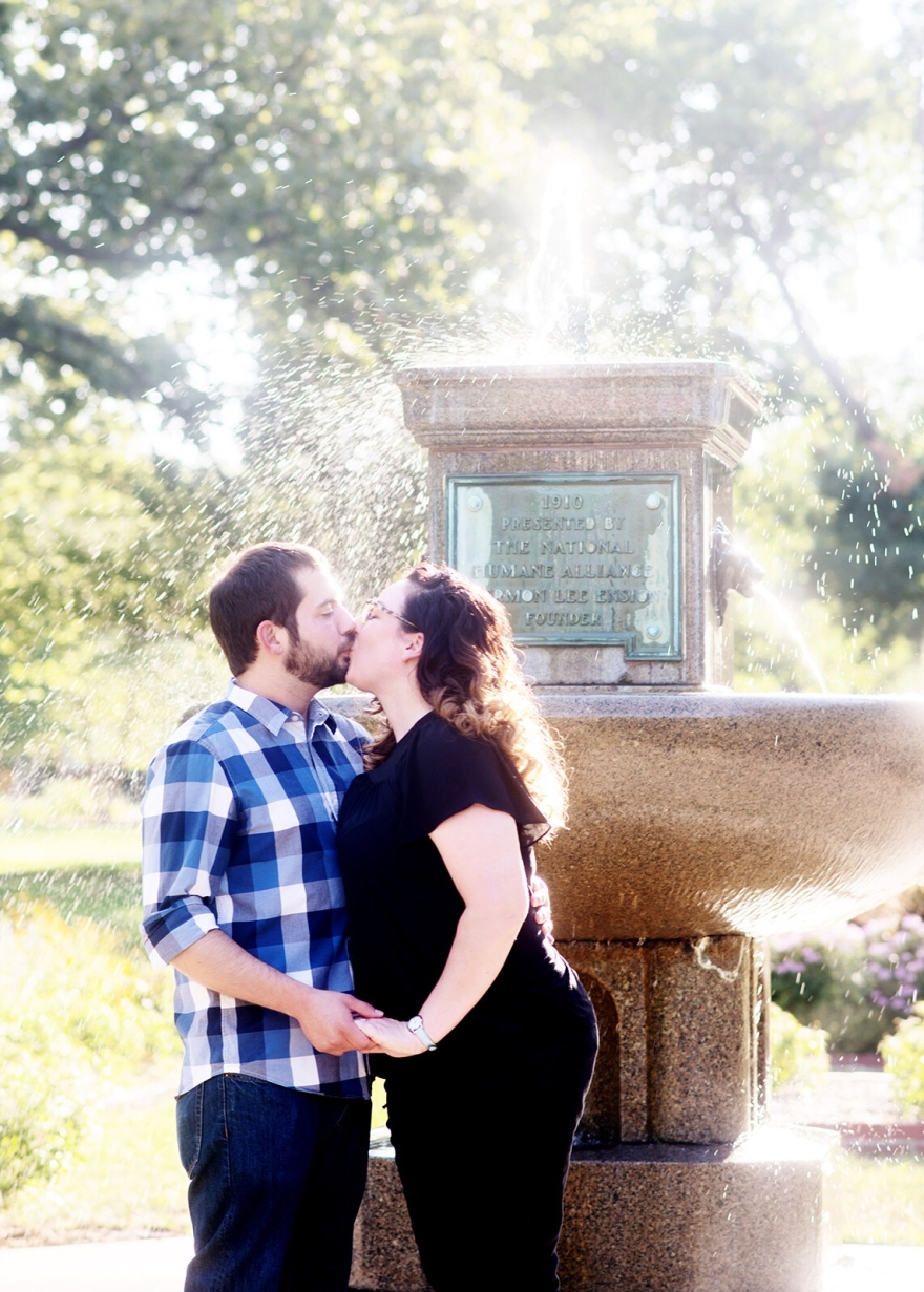 Couple posing for photos by South Park Fountain